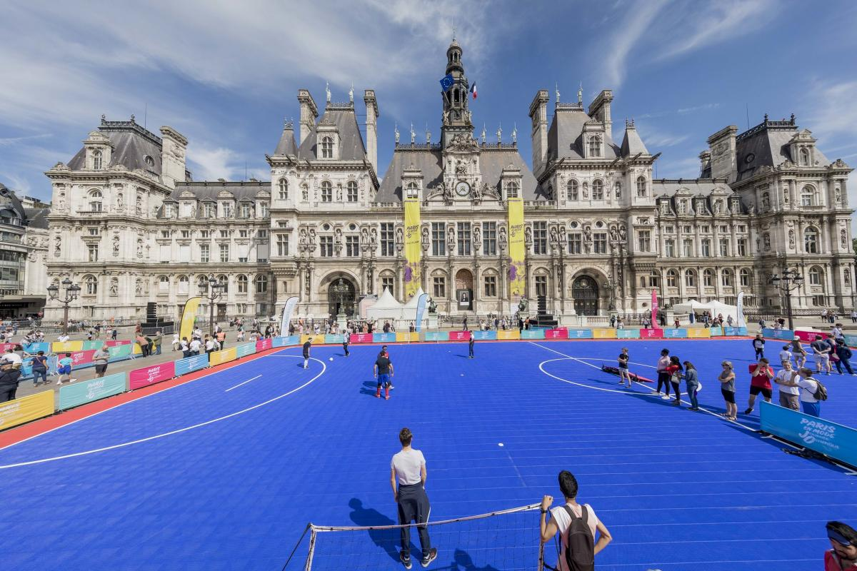 Paris council building with blue turf Football field in front